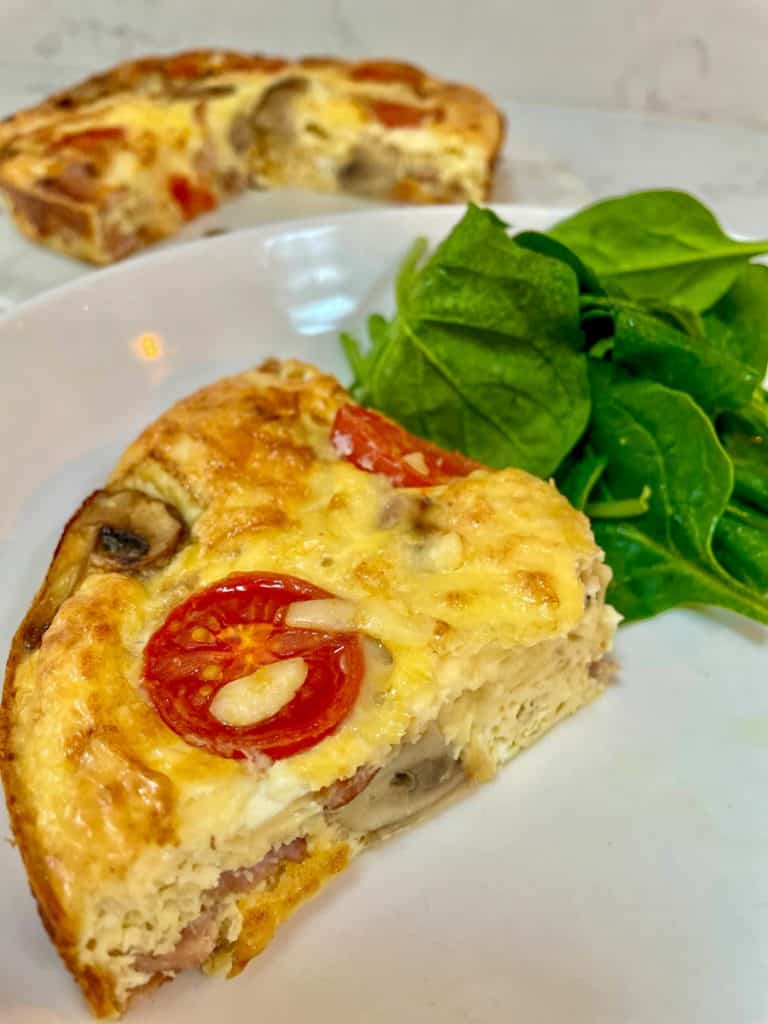 Crustless Quiche slimming style, slice served with spinach