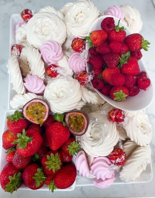 Meringues, strawberries, raspberries grazing board